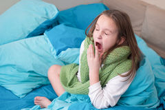 The baby girl with a runny nose. Girl child with a cold holding handkerchief Stock Image