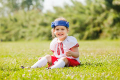 Baby girl in russian folk clothes Stock Images