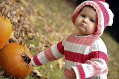 Baby girl's first Autumn Stock Photos