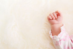 Baby girl's hand on her blanket Royalty Free Stock Photo