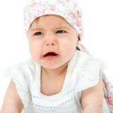 Baby girl with sad face expression. Royalty Free Stock Image
