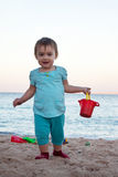Baby girl  on sand beach Stock Image