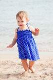 Baby girl  on sand beach Royalty Free Stock Photo