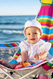 Baby girl on the sand beach with toys. Little baby girl on the sand beach with toys Stock Image