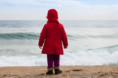 Girl on  beach in  windy day Stock Image