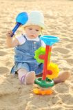 Baby girl  with sand Royalty Free Stock Photo