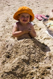 Baby girl in the sand Royalty Free Stock Photos