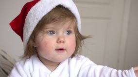 Baby girl in Santa Claus red hat stock video