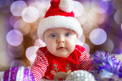 Baby girl in santa costume for Christmas Royalty Free Stock Image