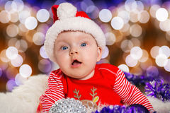 Baby girl in santa costume for Christmas Stock Images