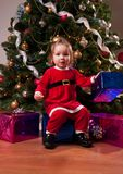 Baby Girl in Santa costume near Christmas tree Stock Photography