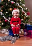 Baby Girl in Santa costume near Christmas tree Royalty Free Stock Photos