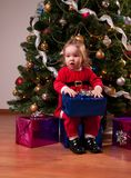 Baby Girl in Santa costume near Christmas tree Stock Photo
