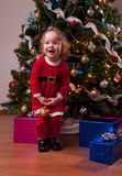 Baby Girl in Santa costume near Christmas tree Royalty Free Stock Photo