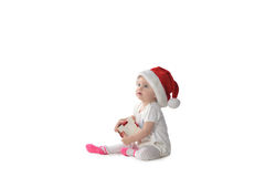 Baby girl in Santa hat Stock Image