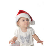 Baby girl in Santa hat Stock Photos