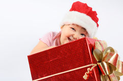 Baby girl in Santa's hat Stock Photos