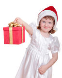 Baby girl in Santa's hat holding gift box Royalty Free Stock Images
