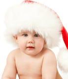 Baby girl in Santa's hat portrait Stock Photos