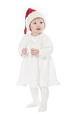 The baby girl in santa's hat with a toy Royalty Free Stock Images
