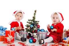 Baby girl santas Stock Image