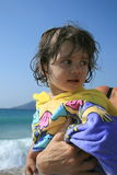 Baby girl at sea Royalty Free Stock Image