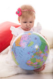 Baby girl search on world globe Stock Photography