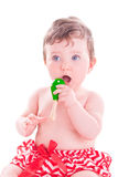 Baby girl with shaker music instrument. Baby girl with green shaker music instrument Royalty Free Stock Photography