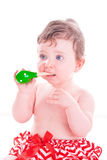 Baby girl with shaker music instrument. Stock Photos