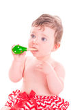 Baby girl with shaker music instrument. Royalty Free Stock Image