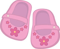 Baby girl shoes. Pink baby girl shoes with flowers Royalty Free Stock Image