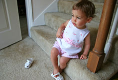 Baby Girl Shoes. Beautiful baby girl putting shoe on wrong foot. Shot with Canon 20D Royalty Free Stock Image