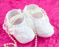 Baby girl shoes Stock Photos