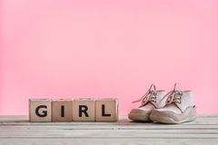 Baby girl shoes on a table Royalty Free Stock Photos