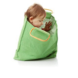 Baby girl in shopping bag Stock Photography