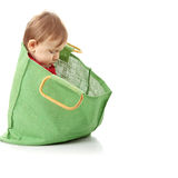 Baby girl in shopping bag Stock Photo