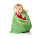 Baby girl in shopping bag Royalty Free Stock Images