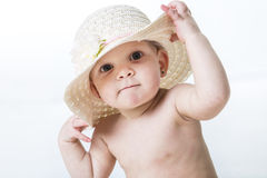 Baby girl showing wearing a hat isolated on white background Royalty Free Stock Images