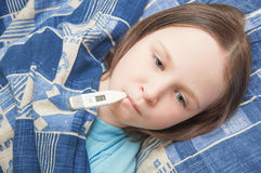 Baby girl is sick with influenza Royalty Free Stock Image