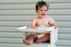 Baby girl sit on high chair Royalty Free Stock Photography