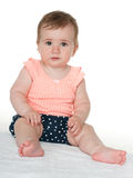 Baby girl sits on the white towel Royalty Free Stock Images