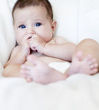 Baby girl sitting Stock Photos