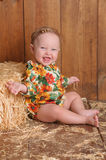 Baby Girl Sitting Against a Straw Bale Stock Photos