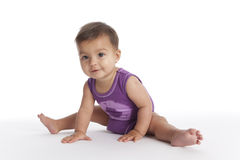 Baby girl sitting in ballet position no.1 Stock Photos