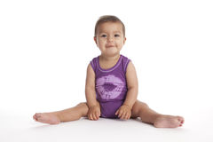 Baby girl sitting in ballet position no.2 Stock Image