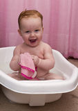 Cute smiling baby girl in the bathtub Stock Photography