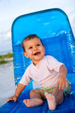 Baby Girl Sitting on Beach Chair Royalty Free Stock Image