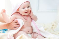 Baby girl is sitting on the bed Royalty Free Stock Photography