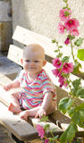Baby girl sitting on bench Royalty Free Stock Photography
