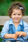 Baby girl sitting on a bench Royalty Free Stock Photography